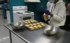 MSD culinary students prepare food in Chef Kurths kicthen to sell to the school.