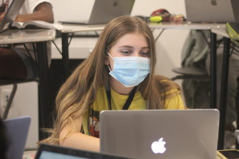 MSD student works on class assignment while wearing their facial covering during class. After a meeting on Oct. 26, BCPS has changed high schools policies on mask to be mask-optional for all students, teachers, administration and staff.