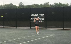 In Action. Heide Dumke is a strategic and hard to beat tennis player. She is excited for the tennis season at Douglas.