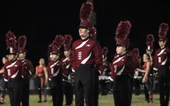 """The Eagle Regiment marching band performs at the homecoming game on Sept. 17. They presented their show, """"Trés Opulent,"""" in front of a packed audience."""