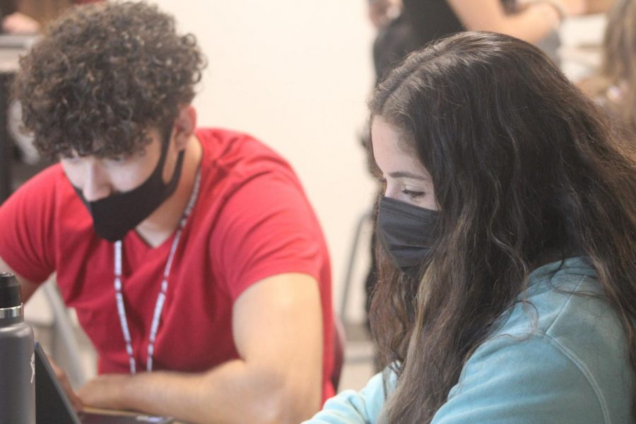 Seniors Ethan Cruz and Hayli Siegel work attentively to complete their group assignment in the English dual enrollment class offered on the school campus. Many students looking to receive college credit take dual enrollment classes at Broward College, at the University of Florida and at Marjory Stoneman Douglas High School.