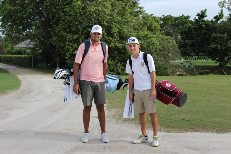 Starting off the season strong. Devan Chahal and Dylan Marrone pose for a picture when walking between holes during a match.